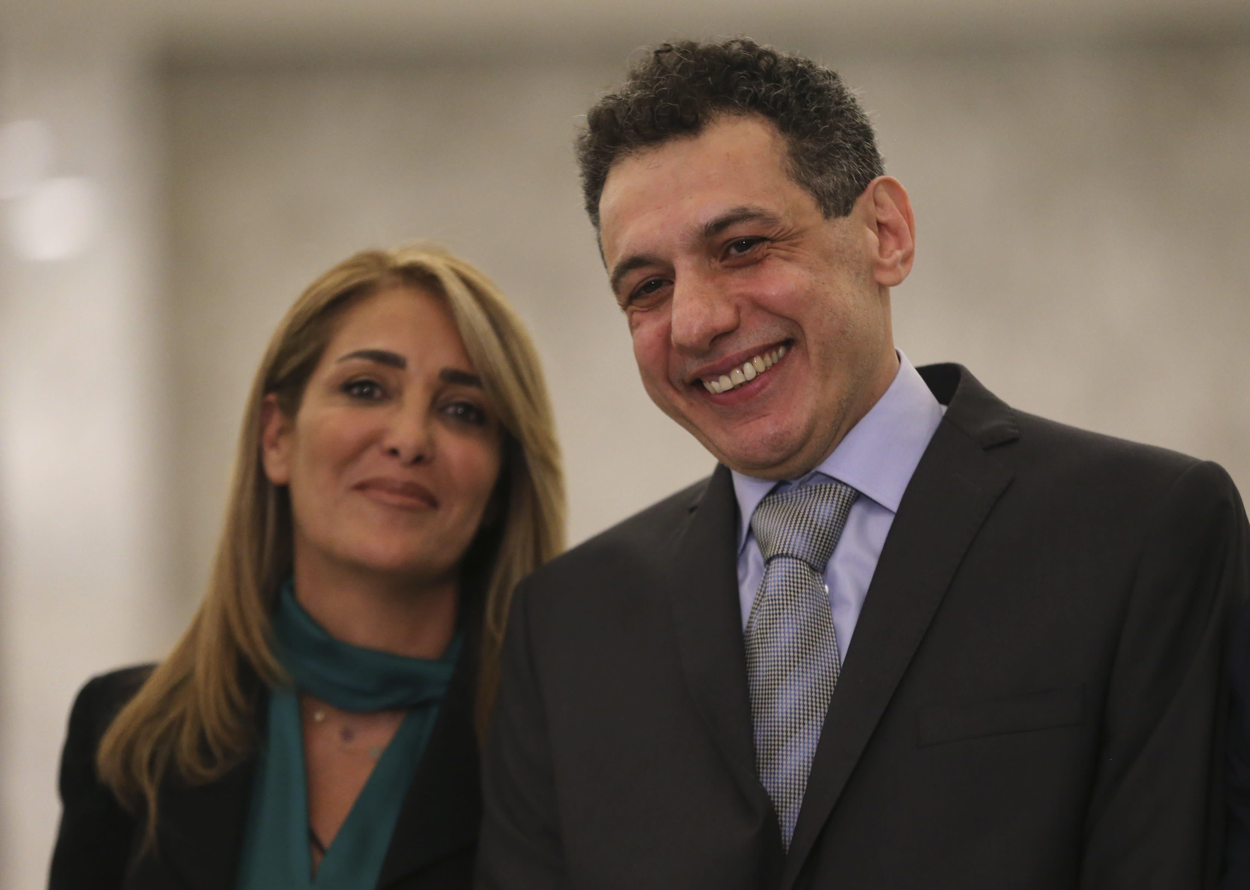 Nizar Zakka, right, a Lebanese citizen and U.S. permanent resident, who was released in Tehran after nearly four years in jail on charges of spying, smiles as he stands next to his wife Ghinwa, at the presidential palace, in Baabda, east of Beirut, Tuesday, June 11, 2019. Zakka a Lebanese businessman was allowed to fly to Lebanon, a development that comes amid heightened tensions between Iran and the U.S. after President Donald Trump withdrew America from Tehran's nuclear deal with world powers. (AP Photo/Hussein Malla)