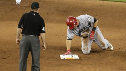 Mike Trout to miss at least a month after injuring thumb during slide