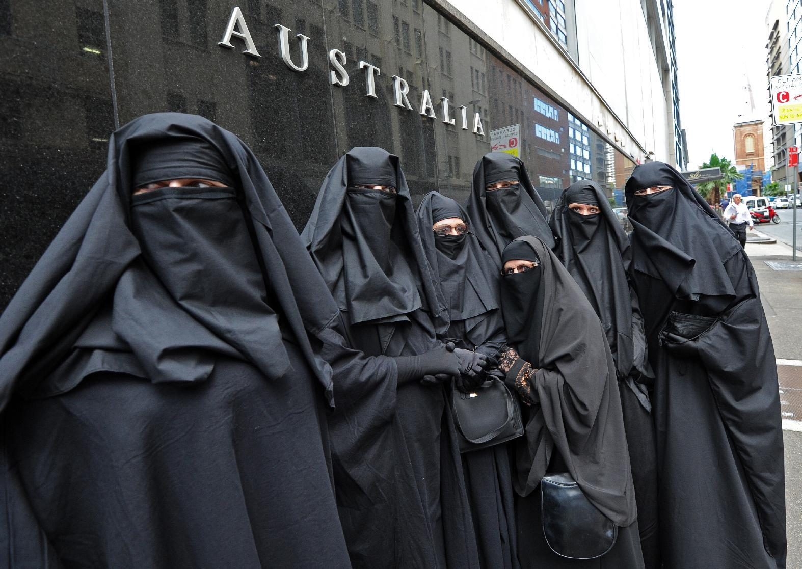 A file photo shows activist group 'Faceless', calling for the banning of conservative Muslim dress in Australia during a rally in Sydney, April 2012 (AFP Photo/Torsten Blackwood)