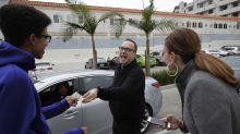 Priest takes pope's mandate - good deeds for all - across US