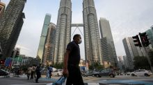 Malaysia says no more 'fist bumps' as coronavirus numbers jump