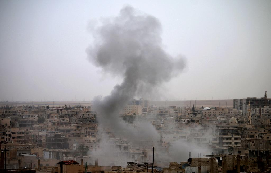 Smoke rises from buildings in a rebel-held neighbourhood of Daraa in southern Syria following reported shelling by the regime on May 22, 2018