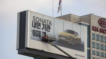 Greenpeace posts protest sign over Hyundai billboard in South Korea