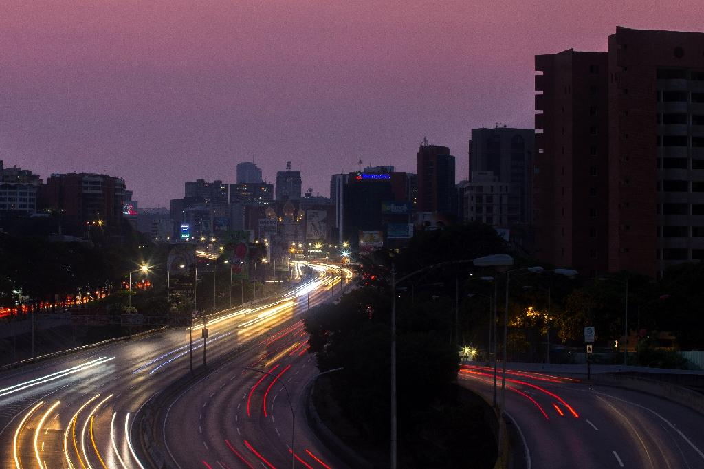 A new power outage is hitting large parts of Venezuela: The Francisco Fajardo highway partially illuminated during a blackout last month in Caracas (AFP Photo/Cristian HERNANDEZ)