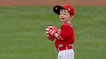 See young Reds fan's determined first pitch