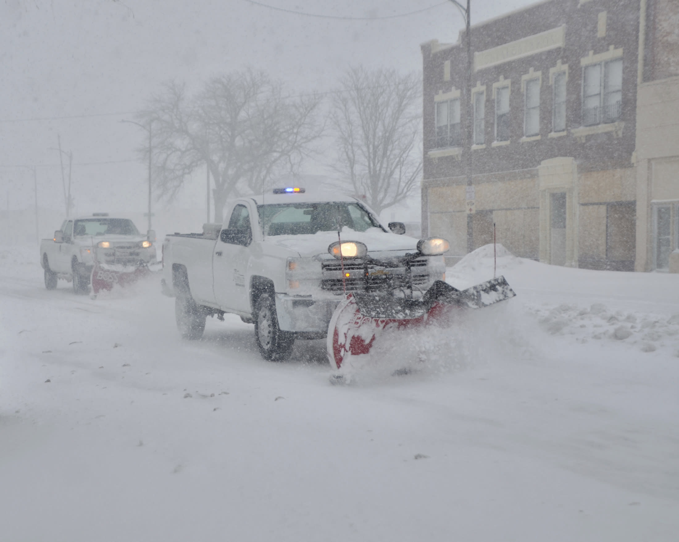 Late-winter storm moves to Upper Midwest; flooding remains