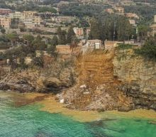 Italy landslide drags 200 coffins into the sea near popular tourist resort