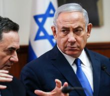 Netanyahu hands Israel foreign minister role to right-wing rival