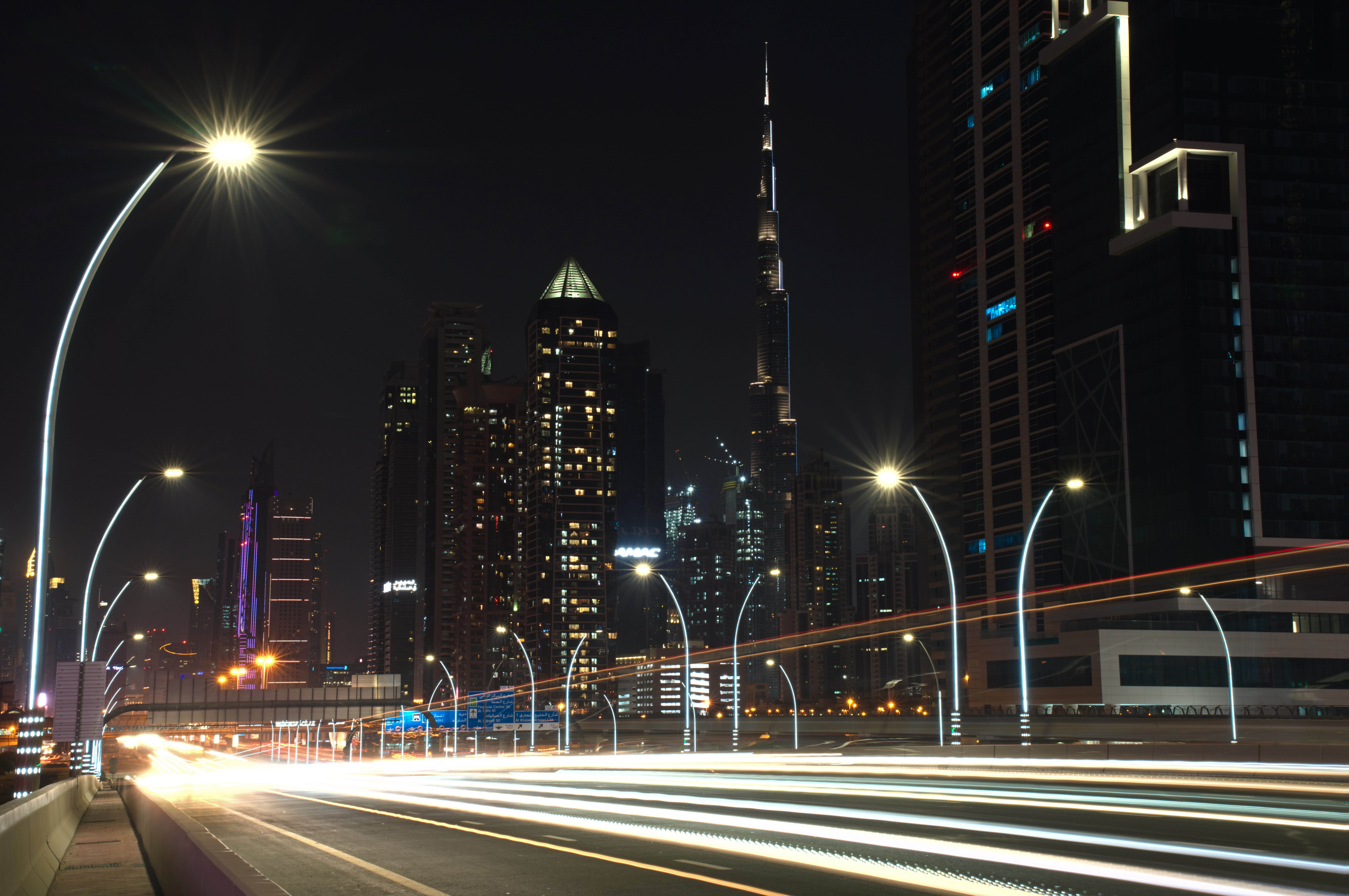 In this photo taken with a slow shutter speed, traffic speeds down the Sheikh Zayed Road in Dubai, United Arab Emirates, Monday, July 6, 2020. Dubai reopened for tourists Tuesday amid the coronavirus pandemic, hoping to reinvigorate a vital industry for this city-state before its crucial winter tourist season. (AP Photo/Jon Gambrell)