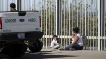 Advance guard of caravan reaches U.S. border — and waits