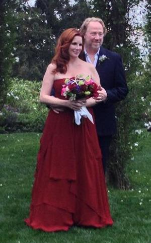 Melissa gilbert wears a red dress to marry timothy busfield for Laura ingalls wilder wedding dress