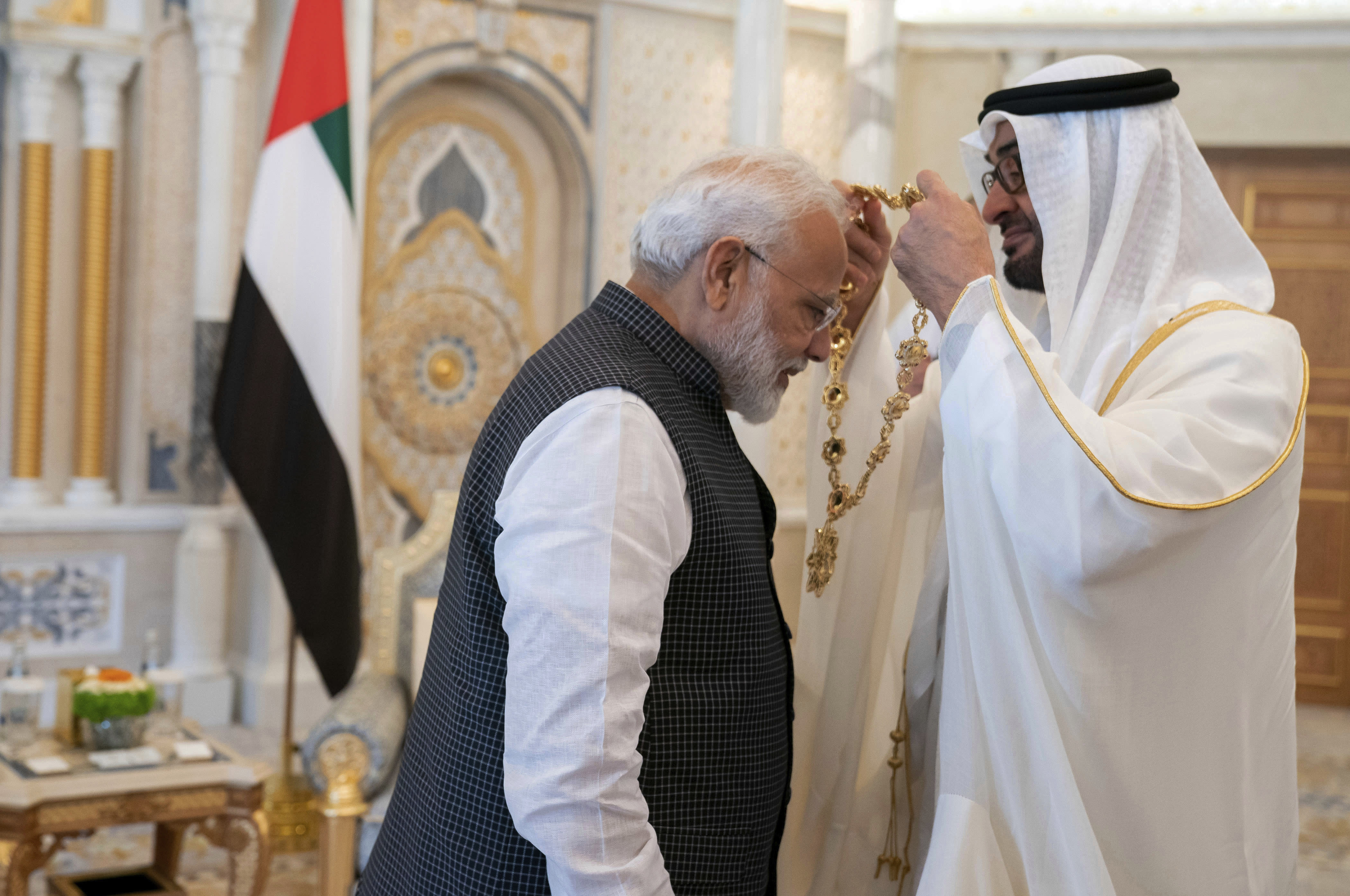 In this photograph made available by the state-run WAM news agency, Indian Prime Minister Narendra Modi, left, receives a medal during his induction to the Order of Zayed from Sheikh Mohammed bin Zayed Al Nahyan, right, in Abu Dhabi, United Arab Emirates, Saturday, Aug. 24, 2019. Modi is on a trip to both the United Arab Emirates and Bahrain, reinforcing ties between India and the Gulf Arab nations as he pursues stripping statehood from the disputed Muslim-majority region of Kashmir. (Hamad al-Kaabi - Ministry of Presidential Affairs/WAM via AP)
