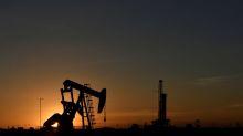 Oil skids on oversupply fears, U.S. stock futures jump