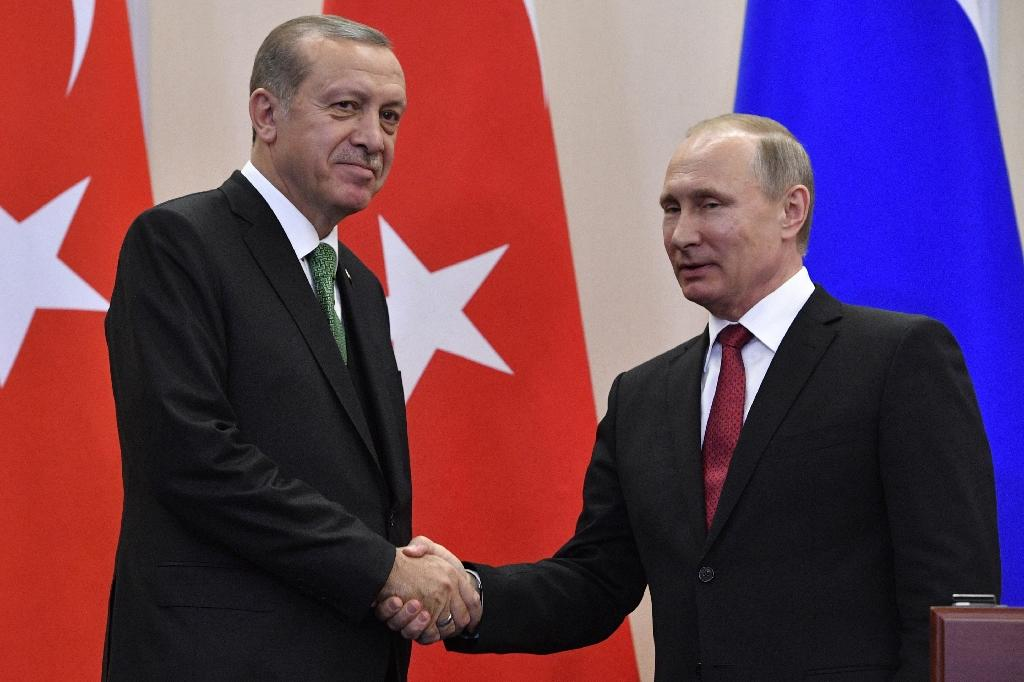 "Russian President Vladimir Putin (R) and his Turkish counterpart Recep Tayyip Erdogan said safe zones in Syria were meant to lead to ""further pacification and cessation of hostilities"" (AFP Photo/Alexander NEMENOV)"