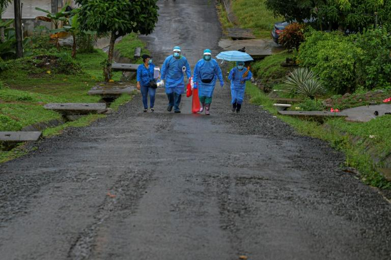 Health care workers face difficulties keeping the coronavirus outbreak under control as many people that know they are infected don't observe containment measures (AFP Photo/Luis ACOSTA)