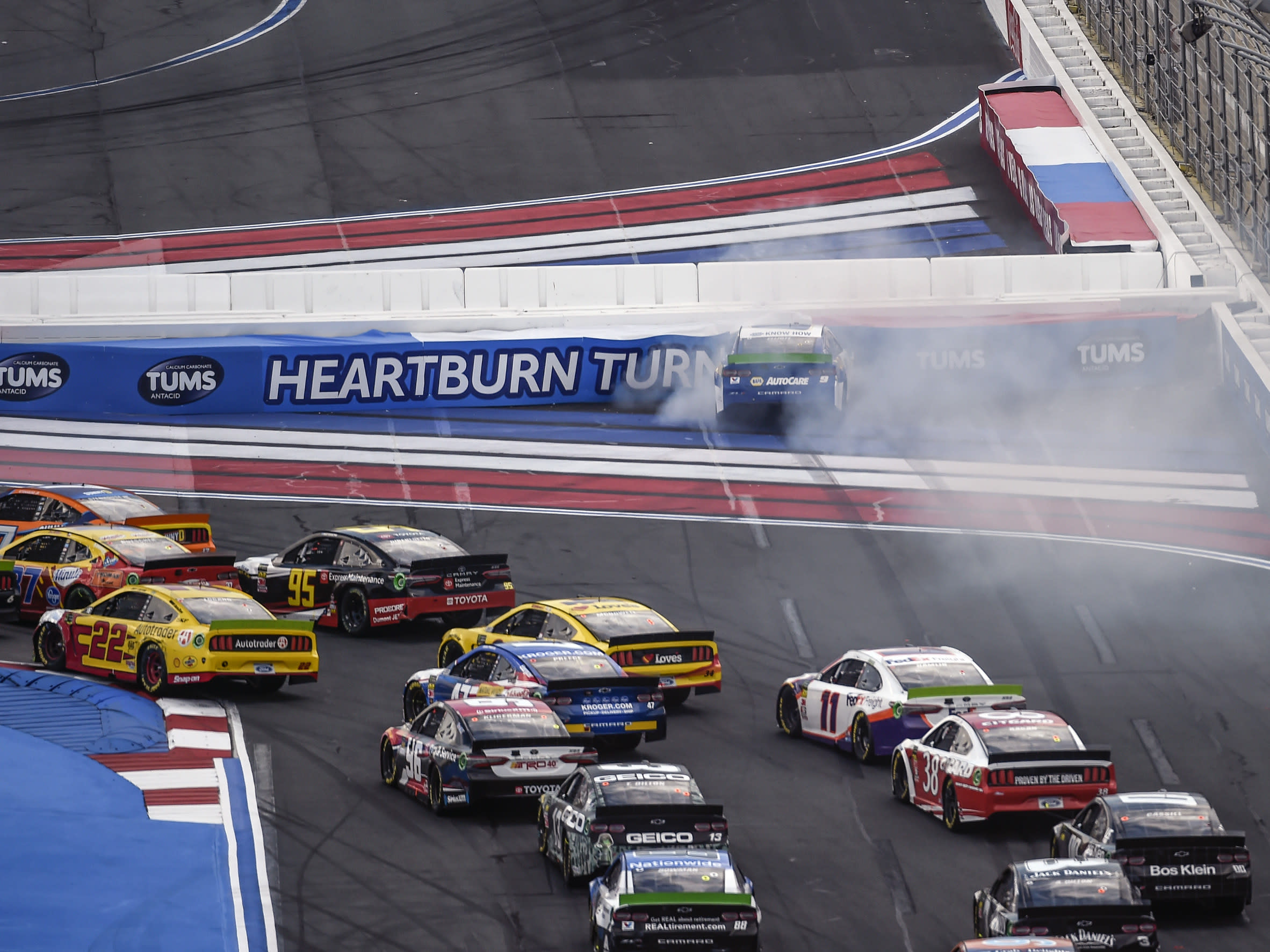Chase Elliott (9) hits the wall in Turn 1 on a restart during a NASCAR Cup Series auto race at Charlotte Motor Speedway, Sunday, Sept. 29, 2019, in Concord, N.C. (AP Photo/Mike McCarn)