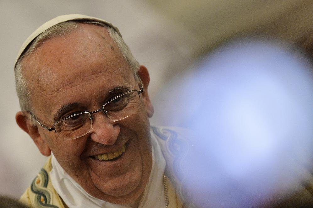 Pope Francis smiles as he leaves at the end of the vespers, at the Basilica of Saint Paul Outside the Walls in Rome on January 25, 2015