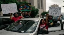 George Floyd death: More large protests in US but violence falls