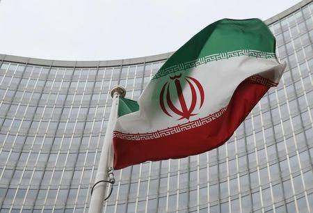 An Iranian flag flutters in front of the IAEA headquarters in Vienna