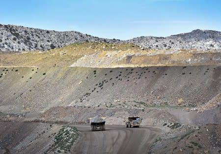 FILE PHOTO: Heavy mining equipment haul ore at the Mountain Pass Rare Earth facility in Mountain Pass, California