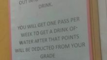 Sign says students get only 'one pass per week to get a drink of water' at elementary school