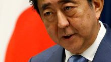 Scandal clouds outlook for Japan's Abe, Tokyo poll may give clues