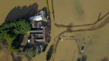 In pictures: Aerial images reveal the extent of flood devastation as River Severn bursts its banks