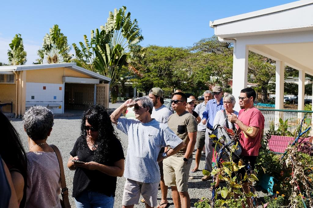 Voters queue outside a polling station, with the participation rate at 73.68 percent an hour before polls closed, much higher than in local elections in 2014 (AFP Photo/Theo Rouby)