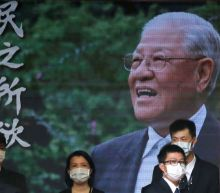 In shadow of China war games, Taiwan bids farewell to 'Mr Democracy'