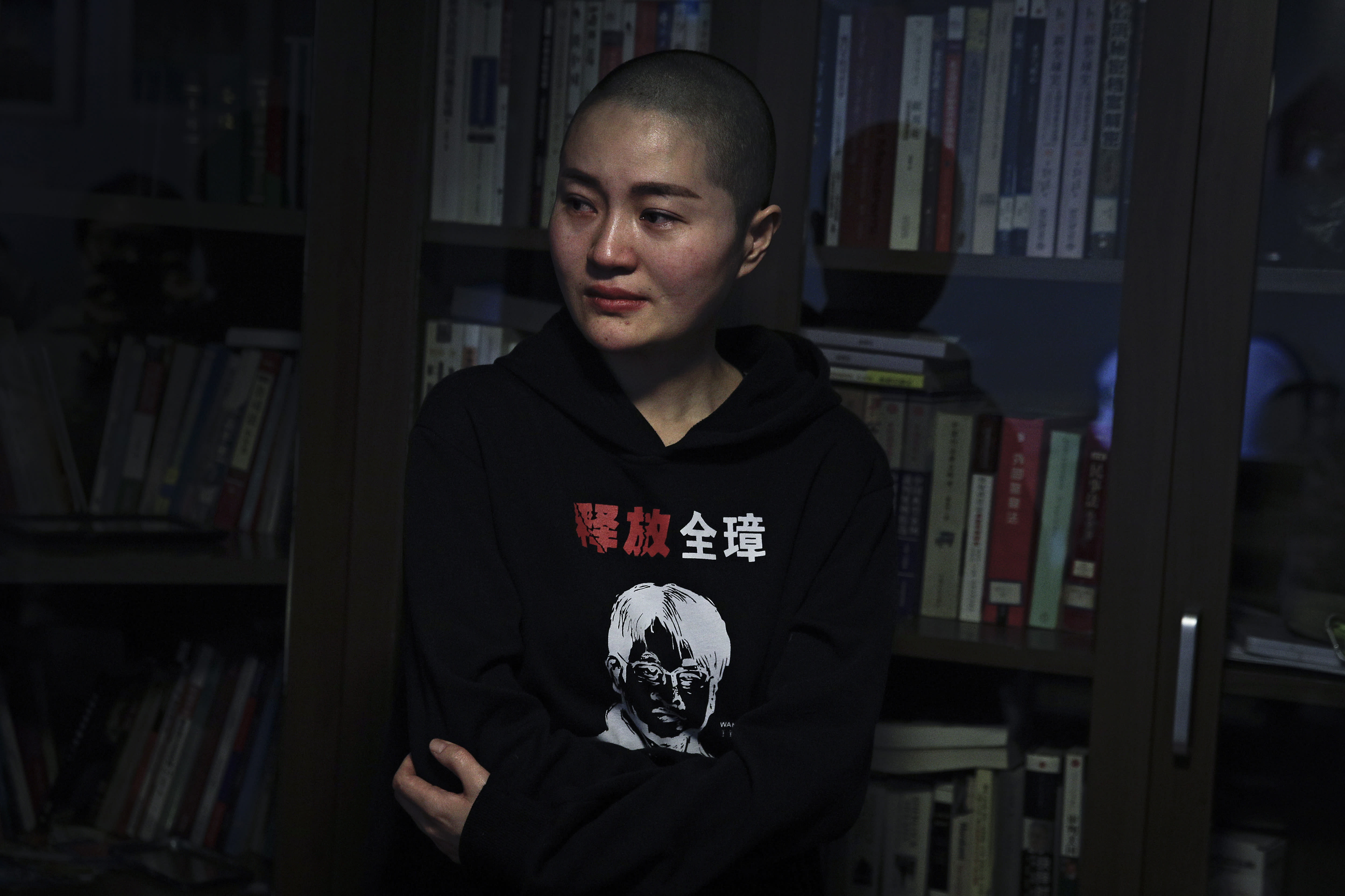 """Li Wenzu, wife of prominent Chinese human rights lawyer Wang Quanzhang wears a sweater with her husband's portrait printed with the words """"Release Quanzhang"""" after Wang's sentencing, at her house in Beijing, Monday, Jan. 28, 2019. Wang was sentenced to 4 and half years in prison on the charge of subversion of state power Monday, more than three years after he was detained in a wide-ranging crackdown on the legal profession. (AP Photo/Andy Wong)"""