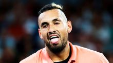 Nick Kyrgios rises above mid-match meltdown to advance in Australian Open