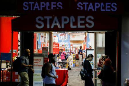 Customers pass by the Staples store in Manhattan, New York