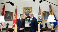 Trump wipes dandruff off visiting French President Macron