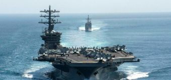 US carrier group's return to Gulf 'not due to threats'