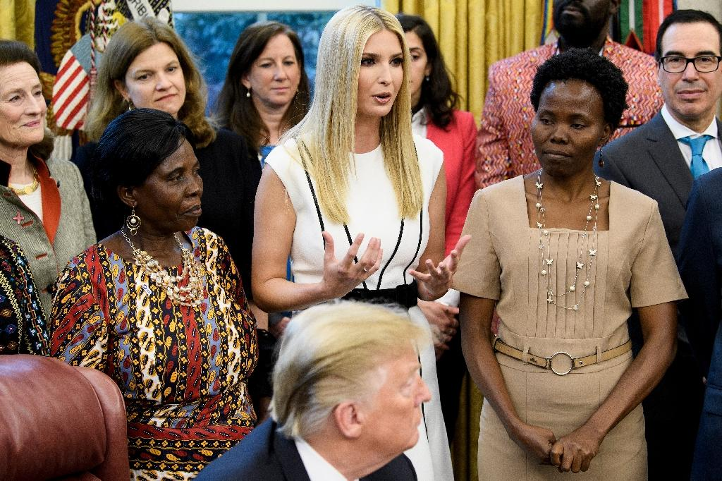 US President Donald Trump's daughter Ivanka Trump (C) speaks during a White House event to launch her Women's Global Development and Prosperity Initiative
