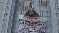 Raw: Italian man protests on St. Peter's dome