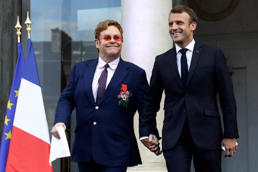 "French President Emmanuel Macron awarded Elton John, 72, the prestigious Legion of Honour a day after the singer's farewell concert in Paris, describing the Briton as an ""icon"""