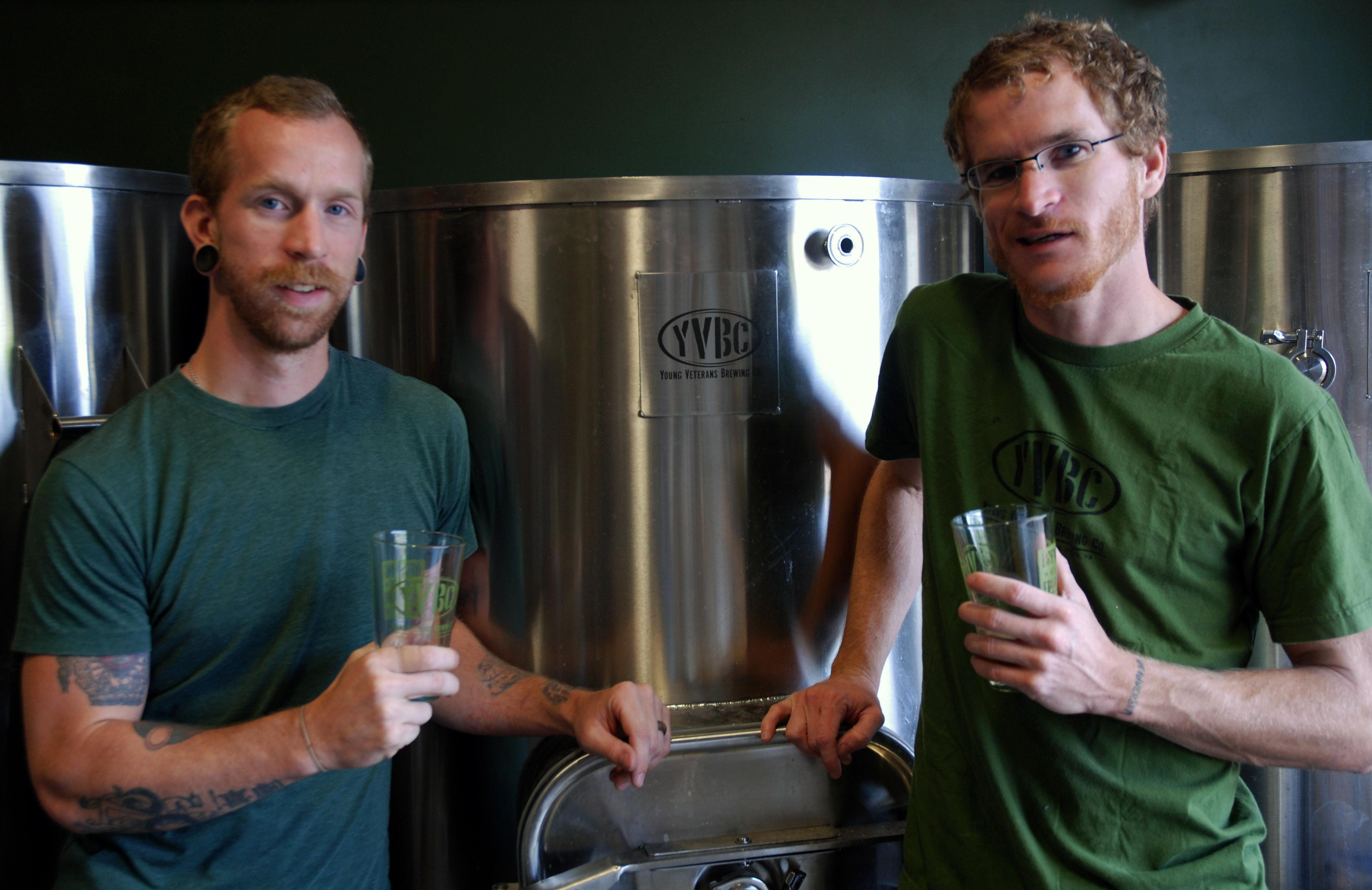 """<p> In a Wednesday, Aug. 14, 2013 photo, Young Veterans Brewing Co. President Thomas Wilder, left, and head brewer Neil McCanon pose for a photo with glasses of """"Jet Noise IPA,"""" at the Virginia Beach, Va., brewery. The two Iraq War veterans are set to open the brewery in military-heavy Hampton Roads in September. Virginia, which is celebrating its second craft beer month in August, has seen the industry grow from about 40 craft breweries last year to more than 60 in 2013, with countless more in the works. (AP Photo/Michael Felberbaum)</p>"""