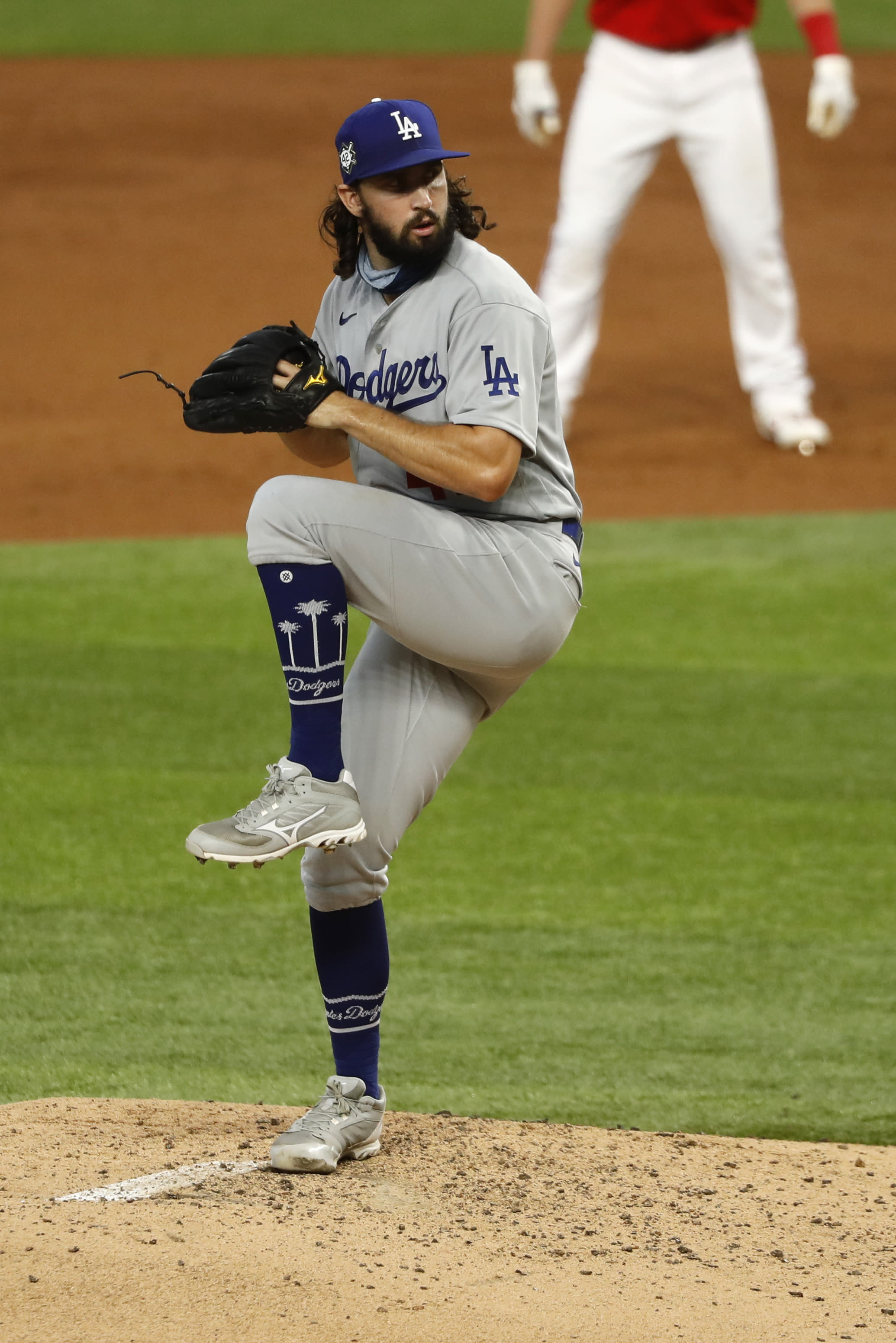 Los Angeles Dodgers starting pitcher Tony Gonsolin throws during the third inning of a baseball game against the Los Angeles Dodgers in Arlington, Texas, Sunday, Aug. 30, 2020. (AP Photo/Roger Steinman)