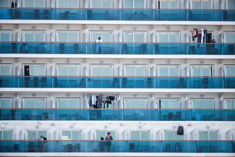 Passengers are seen on the balconies of the quarantined Diamond Princess cruise ship