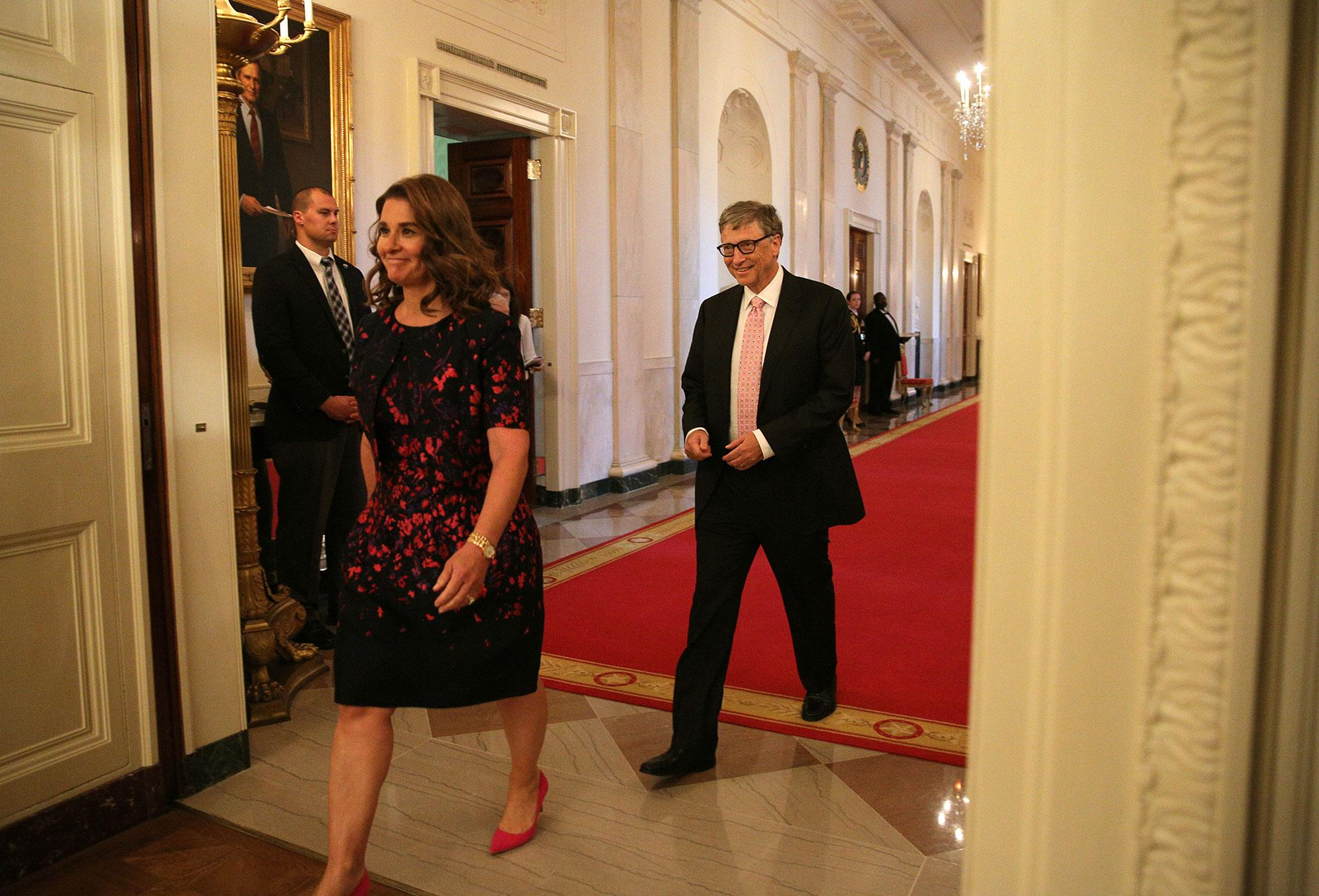 <p>Bill and Melinda Gates walk to their seats before a ceremony awarding the Presidential Medal of Freedom to various recipients in the East Room of the White House in Washington, Nov. 22, 2016. (Carlos Barria/Reuters) </p>