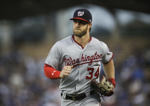 Don't sleep on Bryce Harper's strong right arm. (AP)
