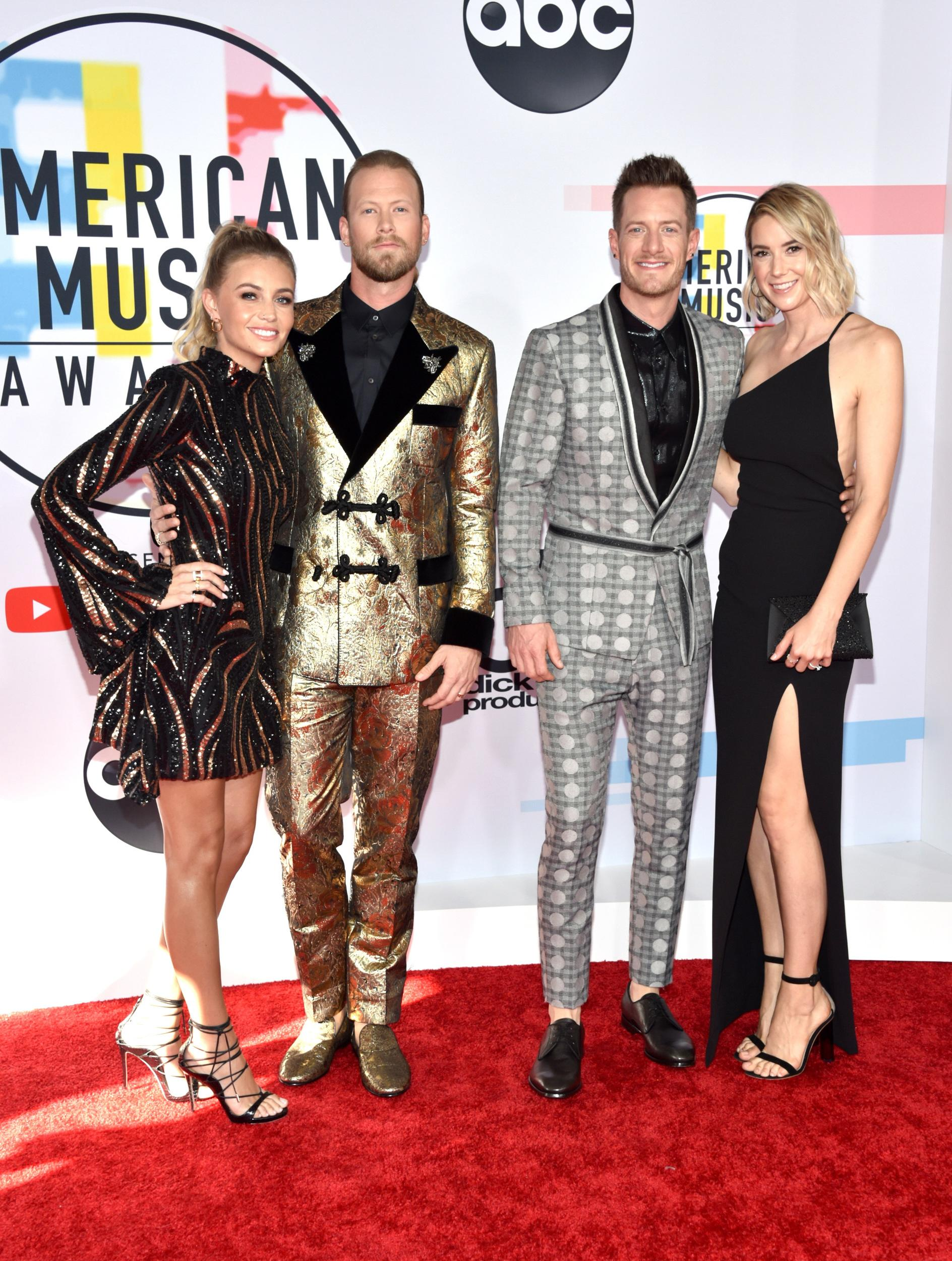 LOS ANGELES, CA - OCTOBER 09:  Tyler Hubbard (2nd L) and Brian Kelley (2nd R) of Florida Georgia Line with Hayley Stommel (L) and Brittany Cole (R) attend the 2018 American Music Awards at Microsoft Theater on October 9, 2018 in Los Angeles, California.  (Photo by John Shearer/Getty Images For dcp)
