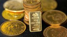 Gold hits 10-month peak on growth worries; dollar dips