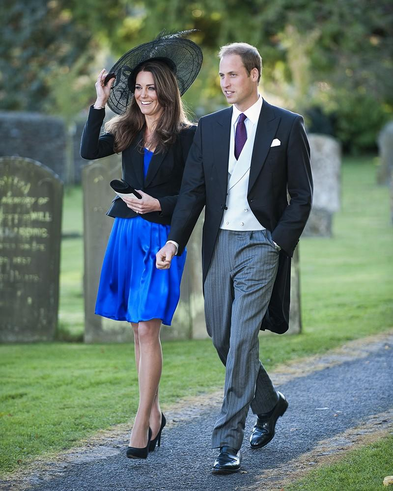 Kate and Wills attend a friend's wedding, Kate wearing a bright silk dress with a black jacket and accessories.