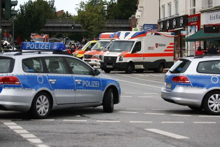 Security forces and ambulances are seen after a knife attack in a supermarket in Hamburg, Germany, July 28, 2017. REUTERS/Morris Mac Matzen