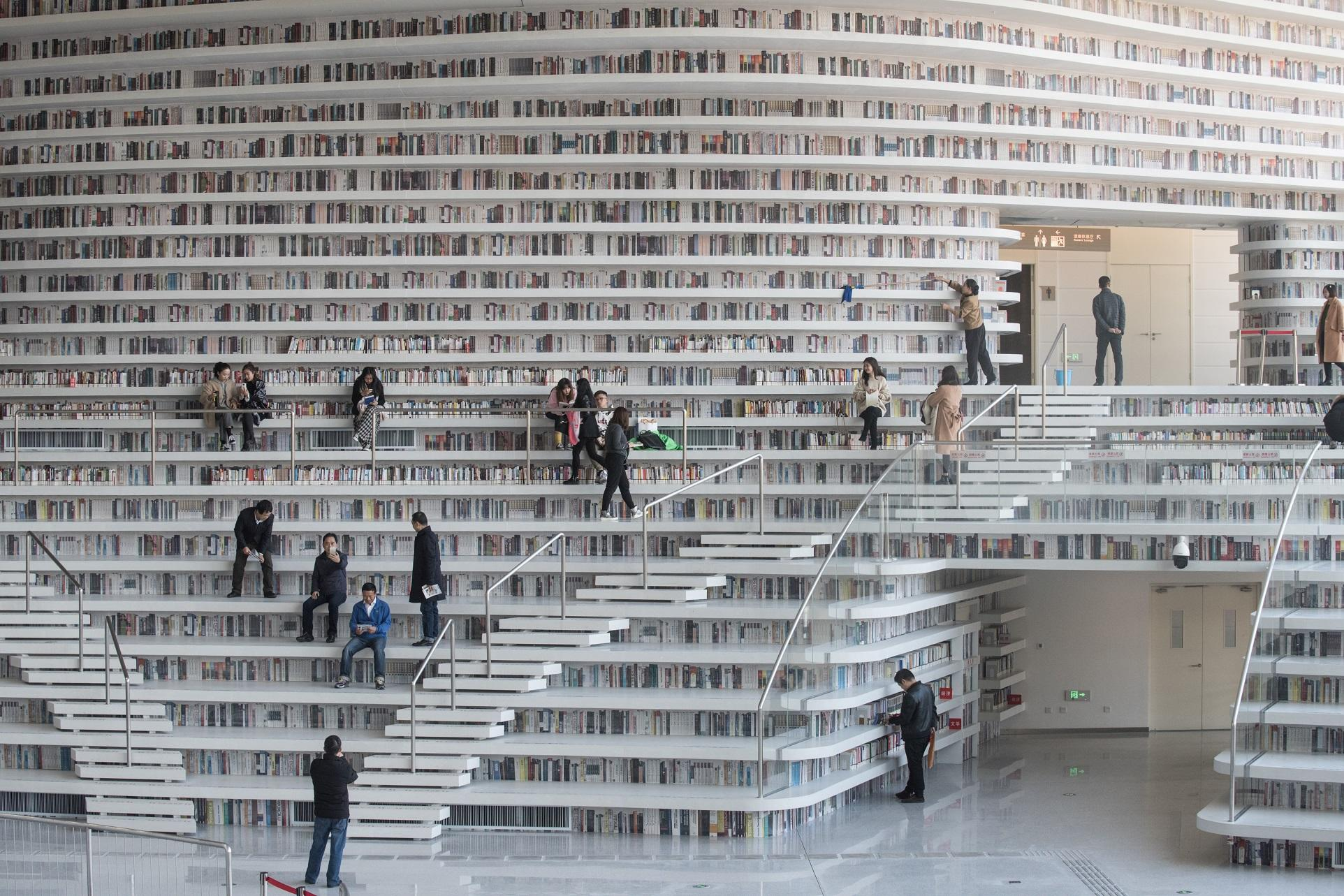 This picture taken on November 14, 2017 shows people visiting the Tianjin Binhai Library, a futuristic Chinese library.