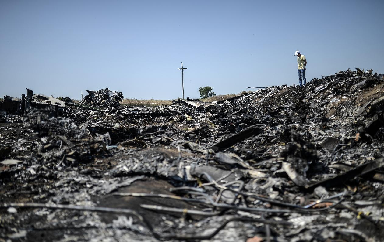 A man stands at the crash site of the Malaysia Airlines Flight MH17 on July 26, 2014, near the village of Hrabove (Grabove), in the Donetsk region (AFP Photo/Bulent Kilic)
