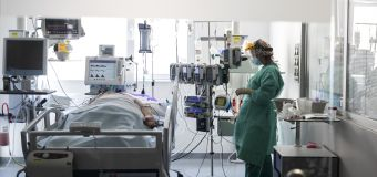 2 in 5 Americans live where COVID strains hospital ICUs