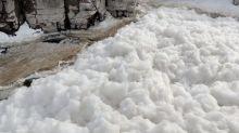 Frothy foam at South Dakota waterfall looks like nature's bubble bath
